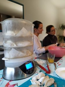 steaming the dumplings in electrical steamer and the discussion in the background